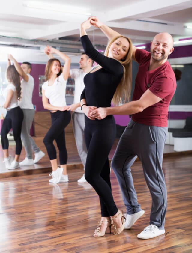 Couple dancing in studio